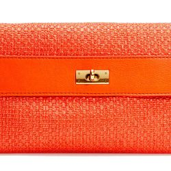 """<b>J.Crew</b> Brompton straw clutch, <a href=""""http://www.jcrew.com/womens_category/handbags/clutch/PRDOVR~65552/65552.jsp"""">$128</a>"""