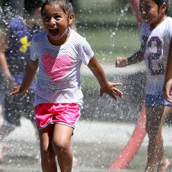Valeria Avila plays in the splash pad at Liberty Park in Salt Lake City on Monday, June 19, 2017.