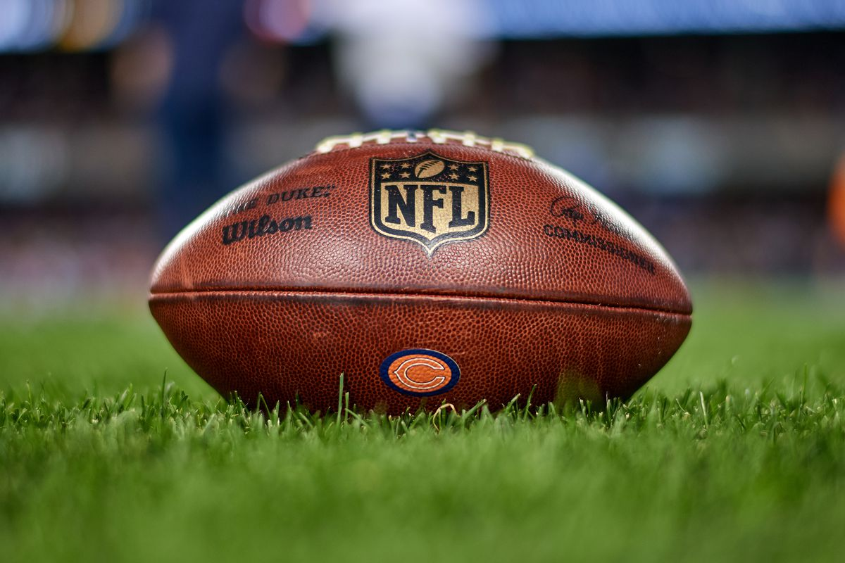 A detail view of the Chicago Bears logo and NFL crest logo is seen on a NFL football prior to game action during a preseason NFL game between the Chicago Bears and the Tennessee Titans on August 29, 2019 at Soldier Field in Chicago, IL.