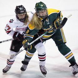 Northeastern University forward Bailey Coyne and Clarkson University forward Lauren Lefler during a game in Boston, MA on Sept. 29.