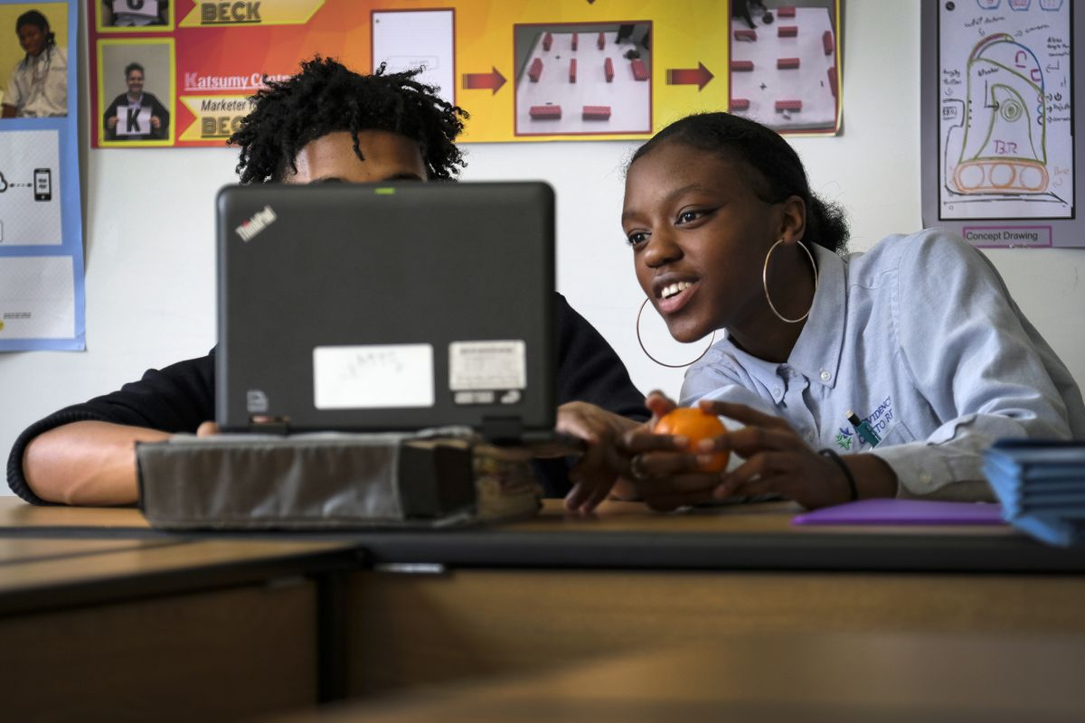 Students in a classroom use a laptop computer at Providence Cristo Rey High School, a private, Roman Catholic high school in Indianapolis, Indiana.