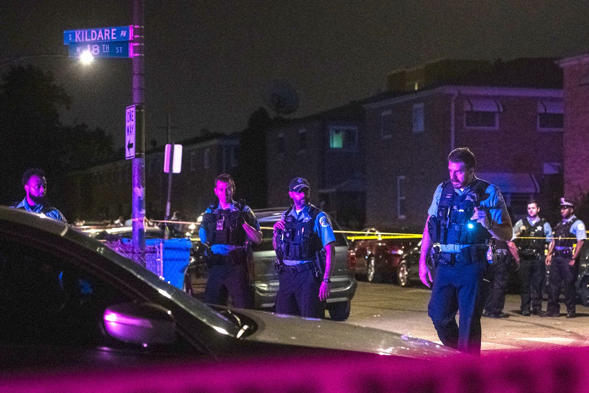 Chicago Police investigate the scene where multiple people were shot, Sunday morning, in the 1800 block of South Kildare, in the Lawndale neighborhood.