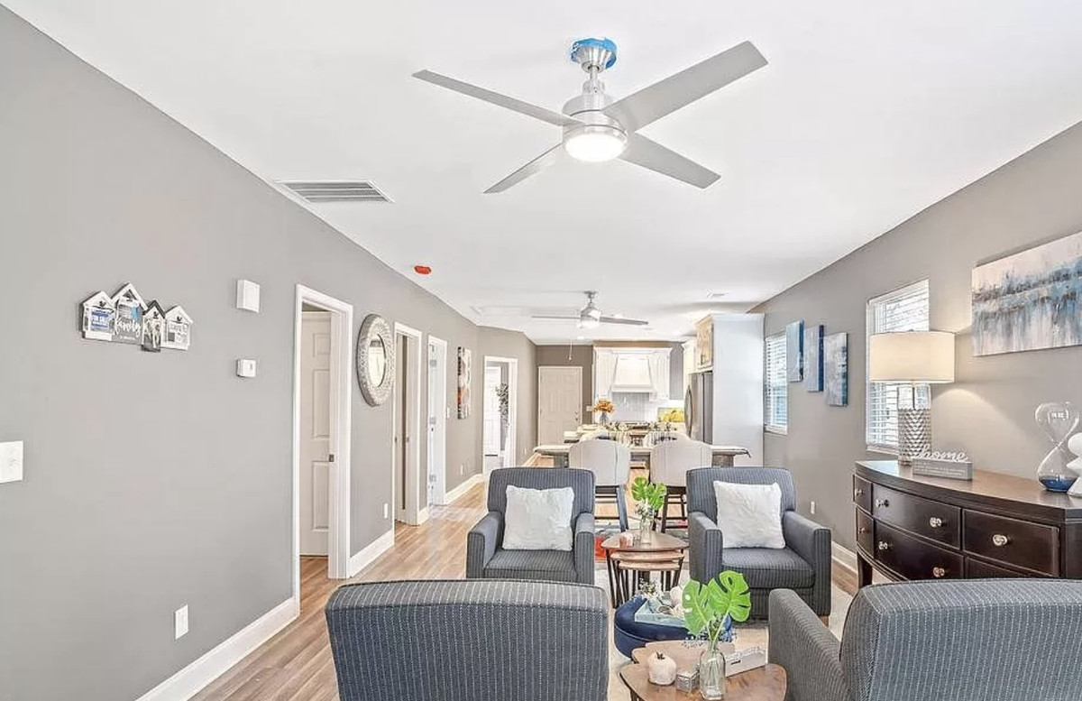 Open floorplan with living area in the front and the kitchen in the back.