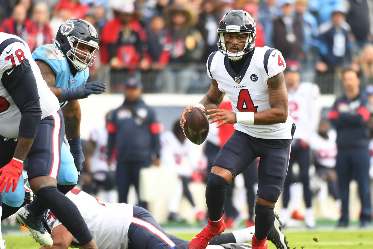 Houston Texans quarterback Deshaun Watson scrambles in the pocket during the first half against the Tennessee Titans at Nissan Stadium.