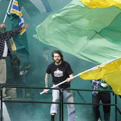 Portland Timber fans celebrate Portland Timbers' Kris Boyd score in the first half during an MLS soccer game with Chivas USA Saturday, April 7, 2012, in Portland, Ore.