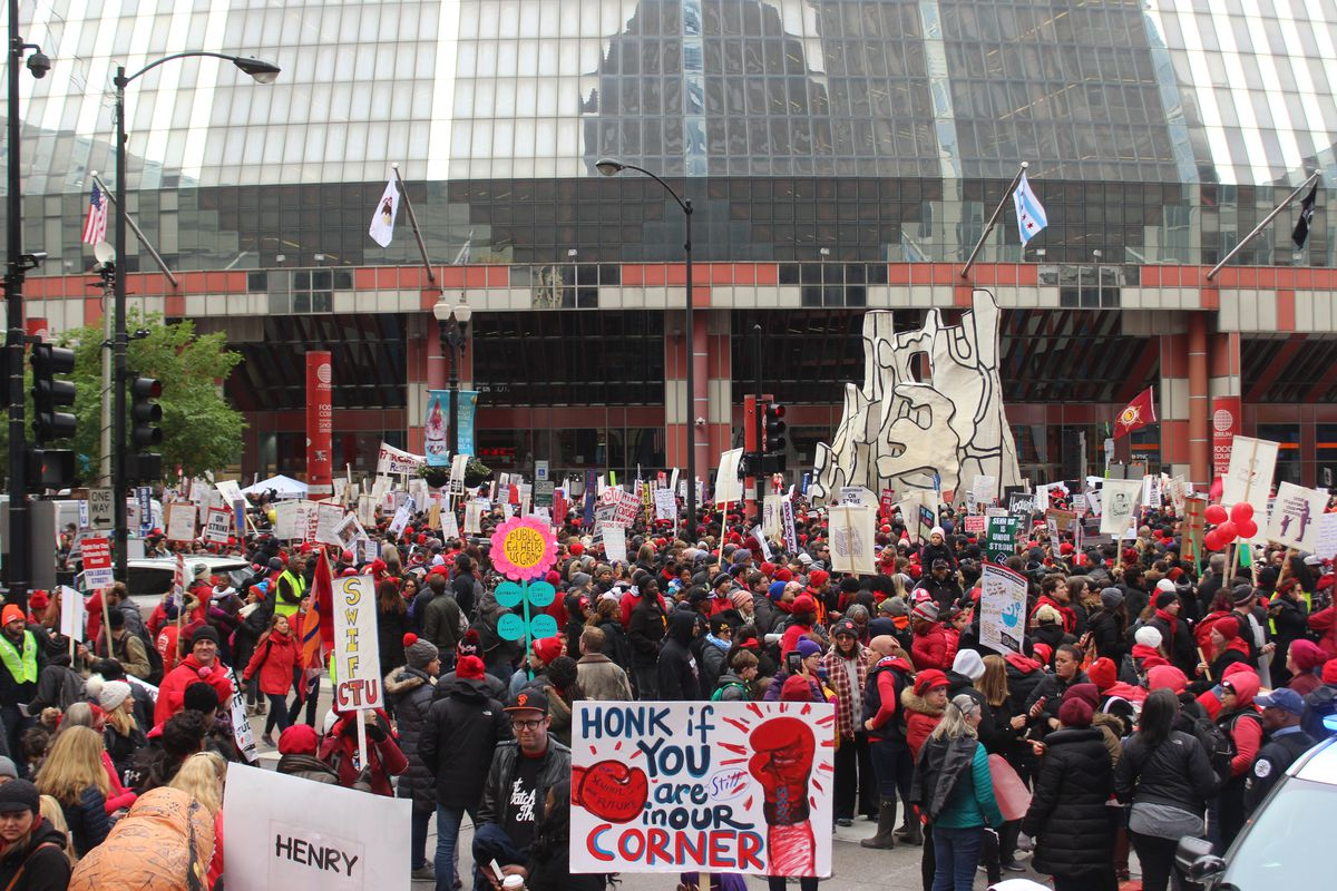 Teachers rally at the Thompson Center Wednesday during a massive gathering that union leaders said drew 30,000.