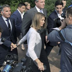 Lori Loughlin depart federal court with her husband, clothing designer Mossimo Giannulli, left, on Tuesday, Aug. 27, 2019, in Boston, after a hearing in a nationwide college admissions bribery scandal.