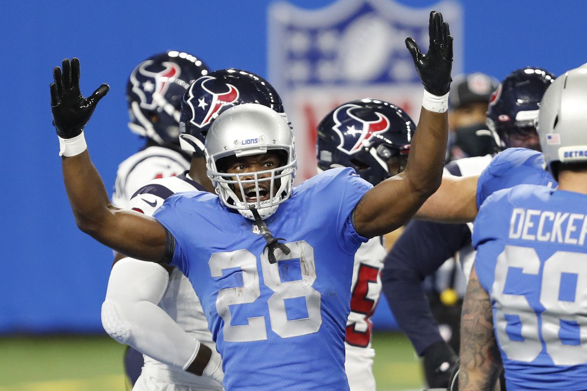 Detroit Lions running back Adrian Peterson (28) raises his arms after a play during the first quarter against the Houston Texans at Ford Field.
