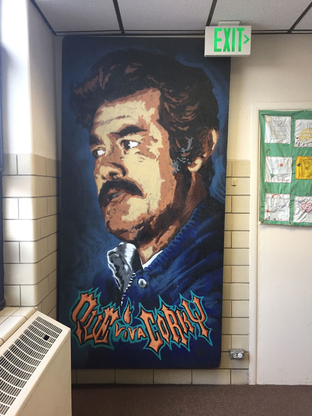 A mural of Corky Gonzales, the founder of Escuela Tlatelolco, on the first floor of the school's building.