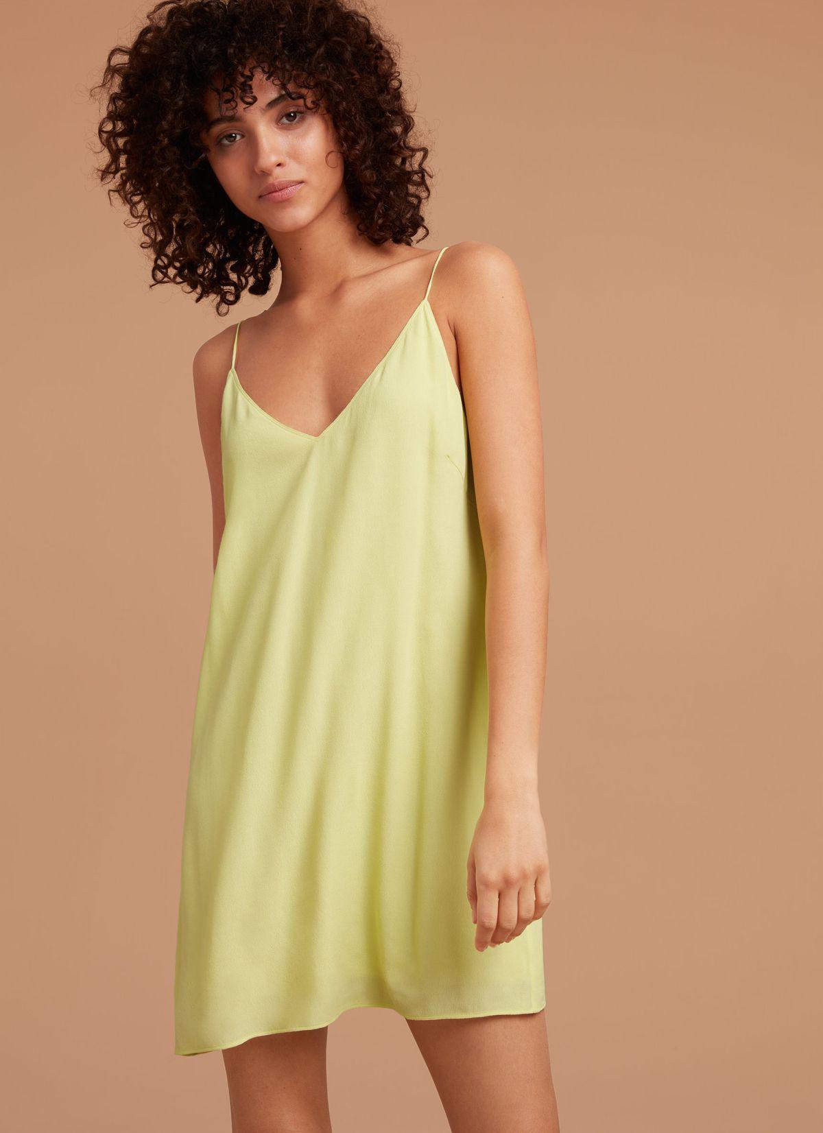 a model wearing a yellow slip dress