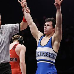 Pleasant Grove's Benjamin Anderson celebrates his fourth straight win in the 152-pound 5A state wrestling championships in Orem Thursday, Feb. 11, 2016.