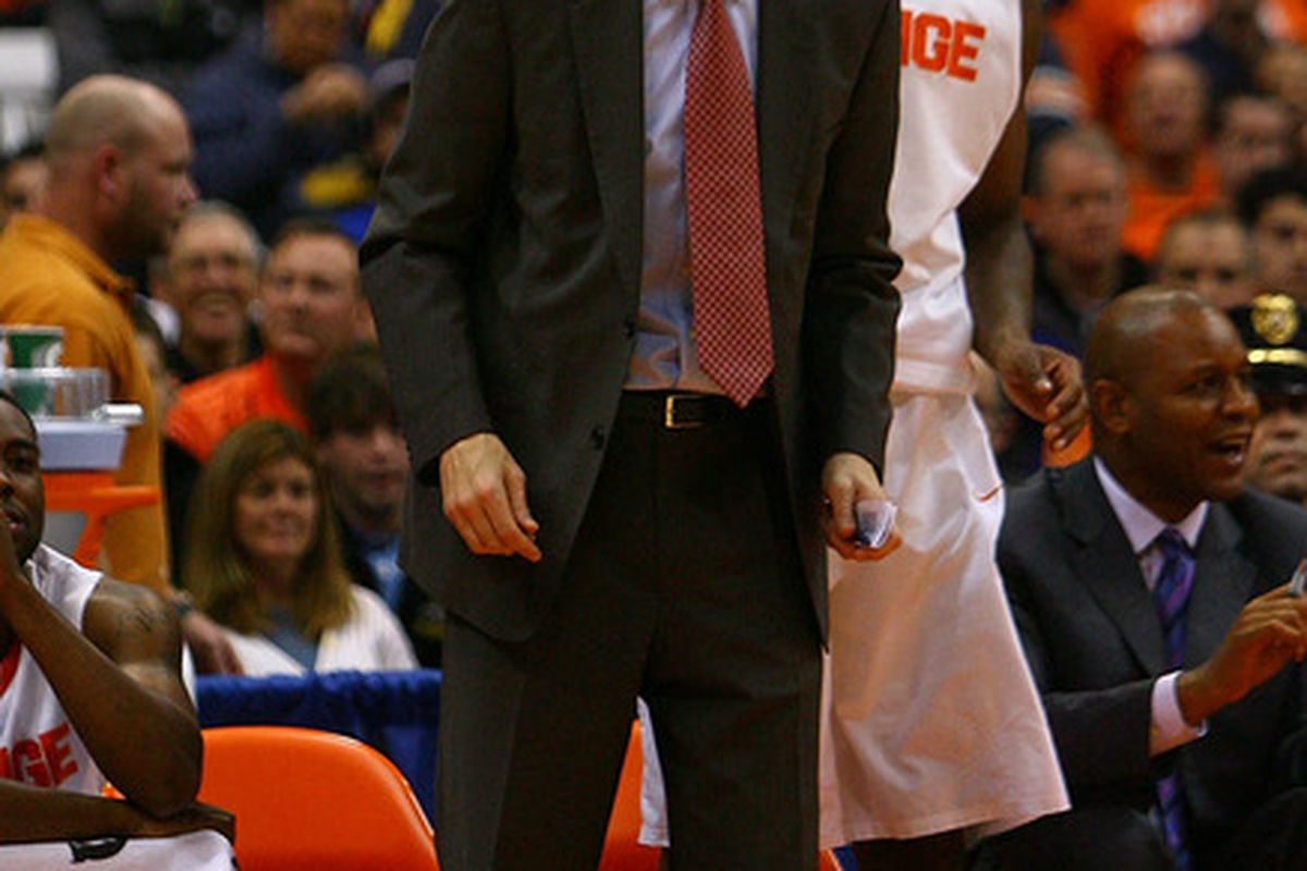 SYRACUSE, NY - NOVEMBER 19: Mike Hopkins, assistant coach of the Syracuse orange yells from the sideline during the game against the Colgate Raiders at the Carrier Dome on November 19, 2011 in Syracuse, New York. (Photo by Nate Shron/Getty Images)