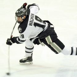 Providence's Jake Walman (19) takes a shot from the point.