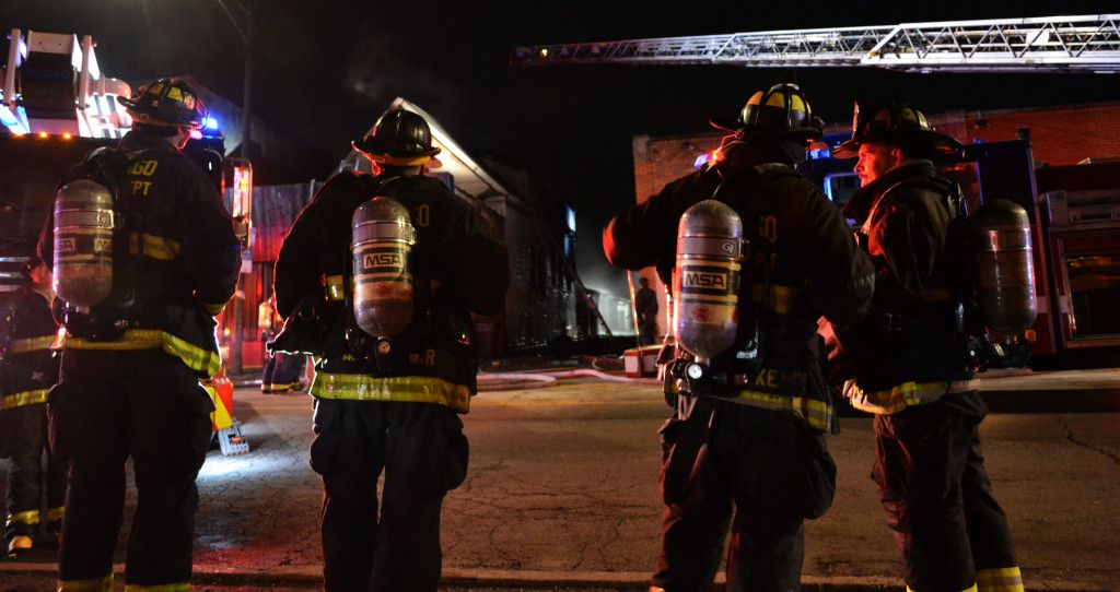 Fire crews respond to a blaze early Friday in the Austin neighborhood that left one person dead and two others, including a firefighter, injured. | Justin Jackson/Sun-Times