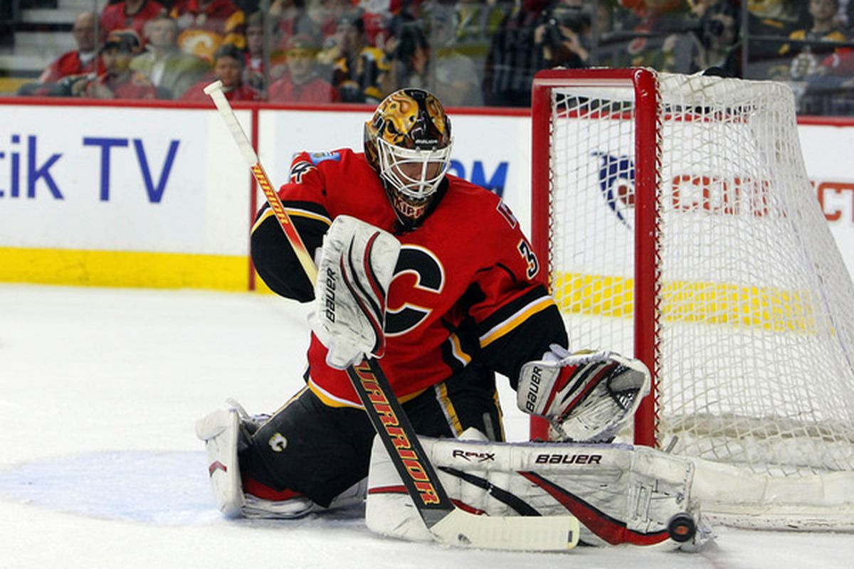CALGARY,CANADA - FEBRUARY 22:  Miikka Kiprusoff #34 of the Calgary Flames makes a save againt the Boston Bruins during their NHL game at Scotiabank Saddledome February 22,2011 in Calgary Alberta Canada.  (Photo By Dave Sandford/Getty Images)