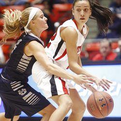 Utah's Danielle Rodriguez, right, tries to get away from Utah State's Devyn Christensen as Utah and Utah State play Nov. 27, 2012, in the Huntsman Center. Utah won 92-64.