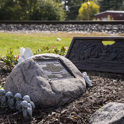 A memorial sits near train tracks at Algonquin Road and Northwest Highway in Fox River Grove, Wednesday afternoon, Oct. 21, 2020. On Oct. 25, 1995, inbound Metra train No. 624 crashed into a school bus at that intersection, killing seven teenagers and injuring the bus driver and 24 passengers.