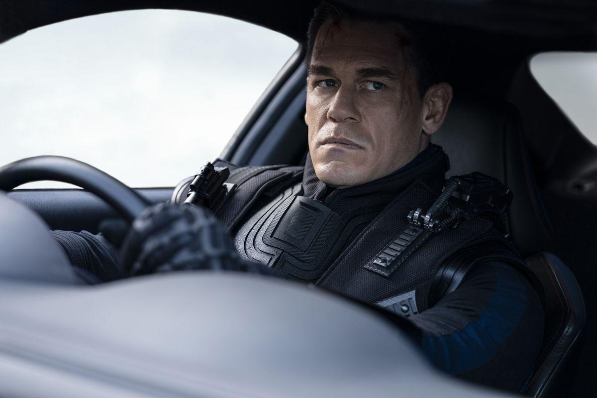 John Cena, behind the wheel of a car in F9.