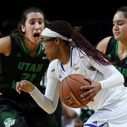 Cal State Bakersfield Roadrunners forward Erika Williams (15) dribbles past Utah Valley University Wolverines guard Gabrielle Leos (21) and Utah Valley University Wolverines guard/forward Sariah Wi Neera (13) in the 2017 WAC Tournament quarterfinals at Orleans Arena in Las Vegas on Wednesday, March 8, 2017.