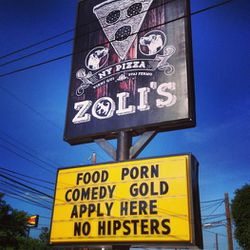 """<em>One of the first signs to go up at Zoli's, the """"no hipsters"""" declaration pissed off at least one Yelper.</em>"""