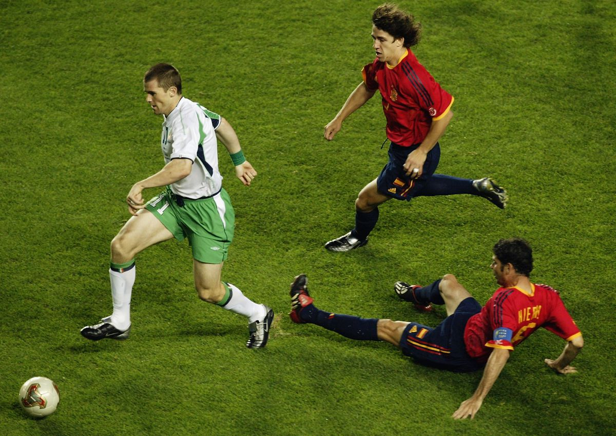 Kevin Kilbane of the Republic of Ireland and Fernando Hierro and Carles Puyol of Spain
