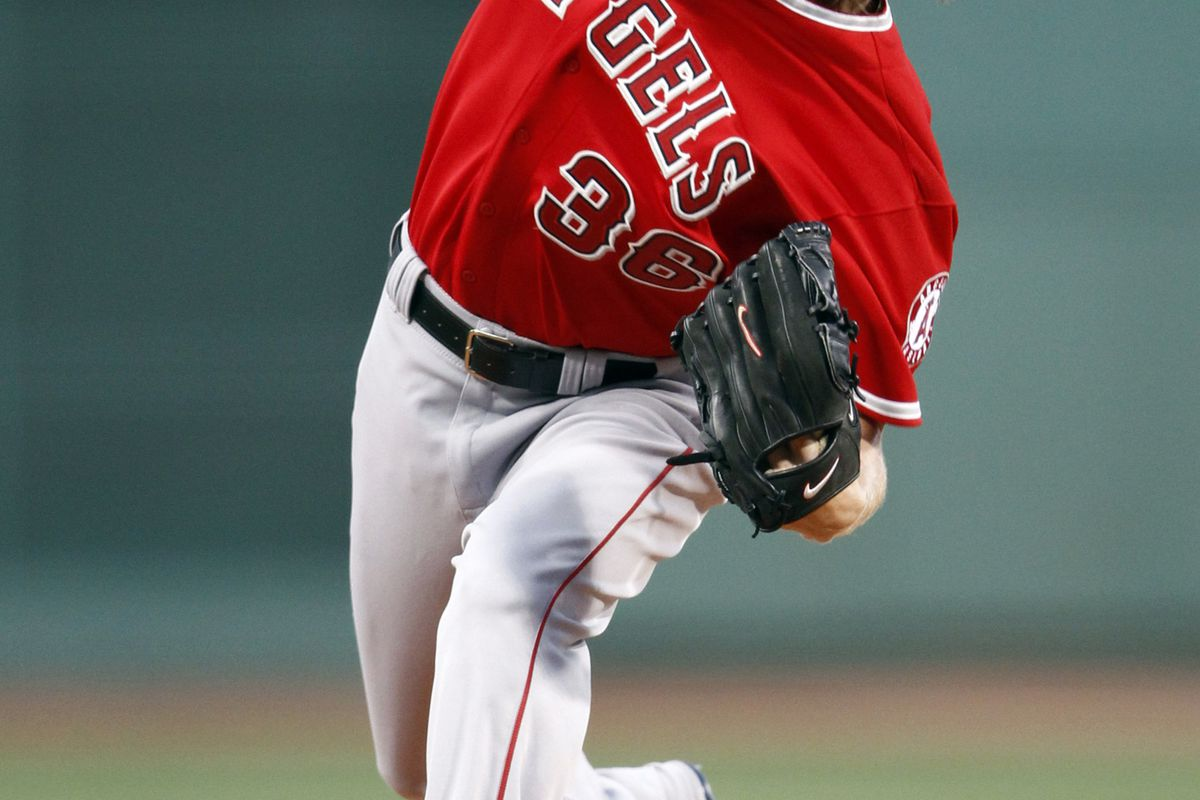 Aug 22, 2012; Boston, MA, USA; Los Angeles Angels starting pitcher Jered Weaver (36) pitches against the Boston Red Sox during the first inning at Fenway Park.  Mandatory Credit: Mark L. Baer-US PRESSWIRE