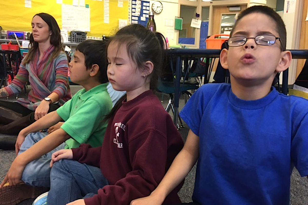 First-graders at Denver's Munroe Elementary do a mindfulness exercise led by school psychologist Amy Schirm.