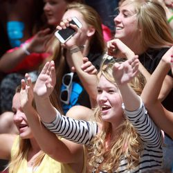 Girls wave their arms as they listen to Beyond 5 perform at the Five-O Fest, a free community festival hosted by the Utah Anti-Bullying Coalition, Safe2Help and the Salt Lake City Police Foundation outside of the Public Safety Building in Salt Lake City on Saturday, May 31, 2014.