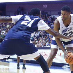 Rudy Gay looks to make a move on Stanley Robinson