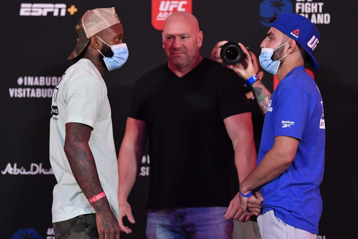 Opponents Malcolm Gordon of Canada and Amir Albazi of Sweden face off during the UFC Fight Night weigh-in inside Flash Forum on UFC Fight Island on July 17, 2020 in Yas Island, Abu Dhabi, United Arab Emirates.