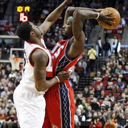 Portland Trail Blazers' Wesley Matthews, left, defends against New Jersey Nets' Gerald Wallace, right, in the first quarter of an NBA basketball game, Wednesday, April 4, 2012, in Portland, Ore.