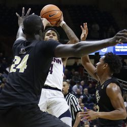 UConn's Jalen Adams (4) puts up the shot that gave him a 1,000 career points in Storrs.