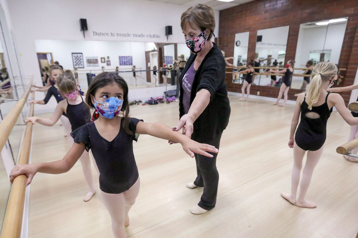 Kate Ostroski raises Yaritza Mendoza's arm as she teaches ballet at Bountiful School of Ballet, which Ostroski co-owns, in Woods Cross on Thursday, Sept. 17, 2020.