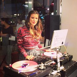 DJ Michelle Pesce wearing Isabel Marant for H&M while attempting to tame the crowds with her soothing sounds.