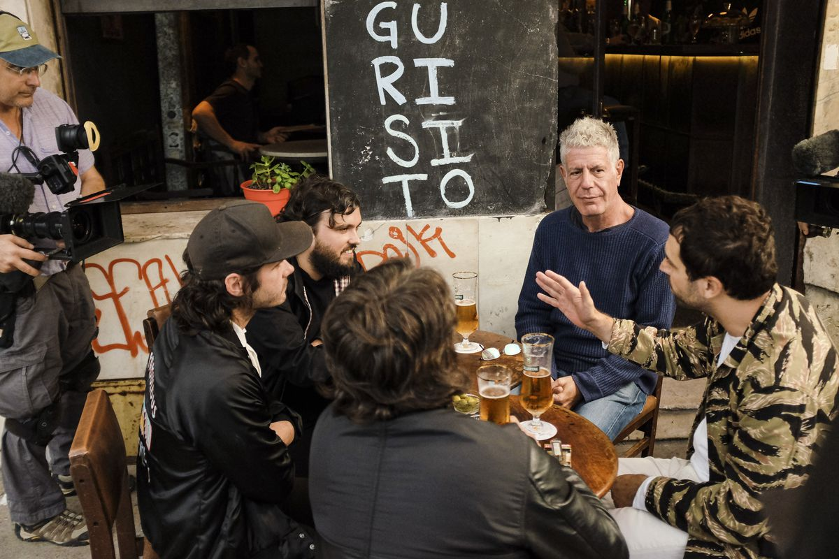 Anthony Bourdain dines with Uruguayans in a scene from this week's Parts Unknown