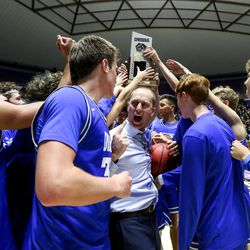 Dixie celebrates after winning the 4A boys basketball championship title at the Dee Events Center in Ogden on Saturday, Feb. 29, 2020.