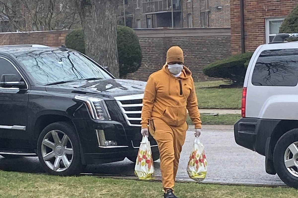 Early Walker, owner of W & W Towing in Dixmoor, personally delivers food care packages to seniors on the South Side Thursday.