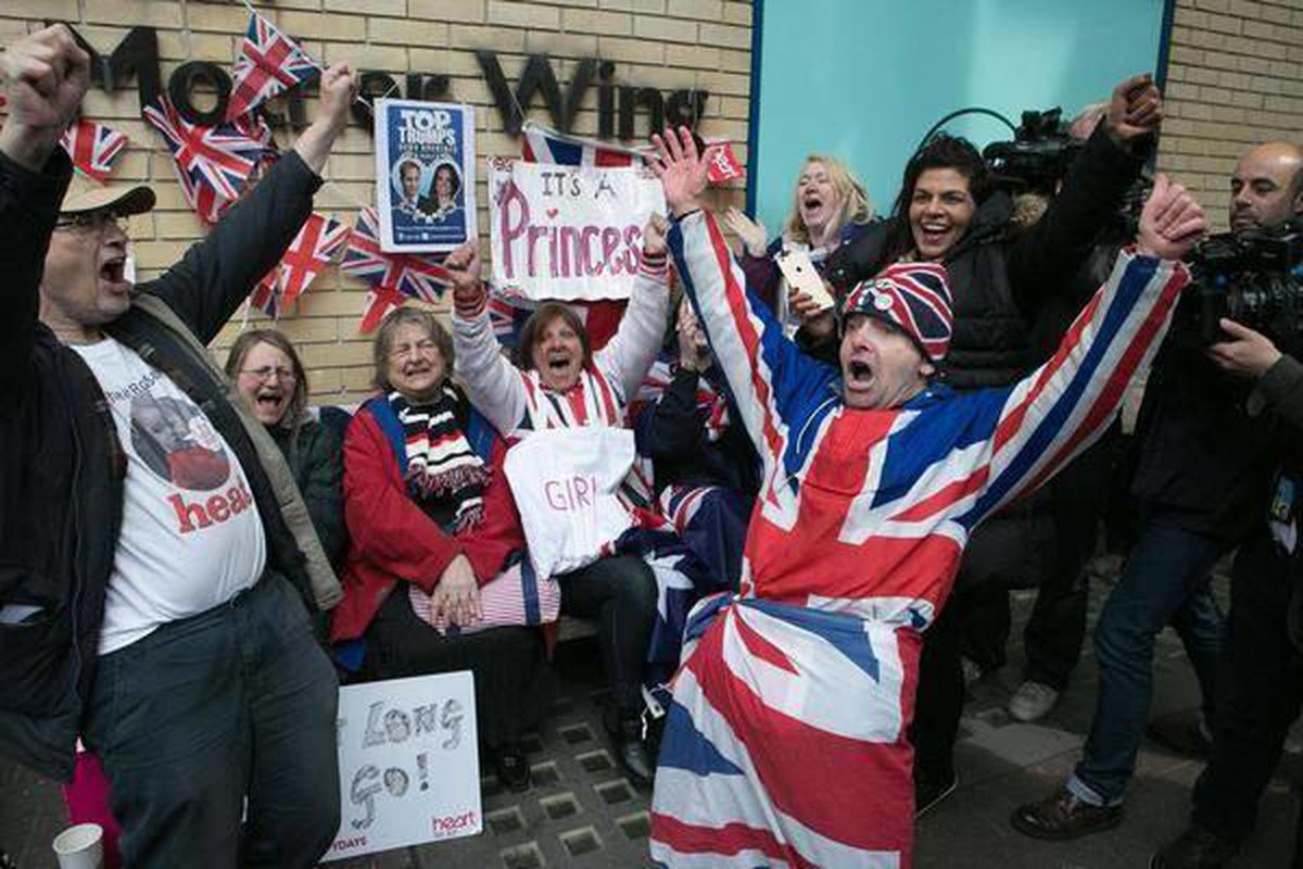 Royal fans and well wishers react after Kensington Palace announced that Kate, the Duchess of Cambridge, had given birth to a girl, outside the Lindo Wing of St. Mary's Hospital, London, Saturday, May 2, 2015. Kensington Palace said in a brief statement t