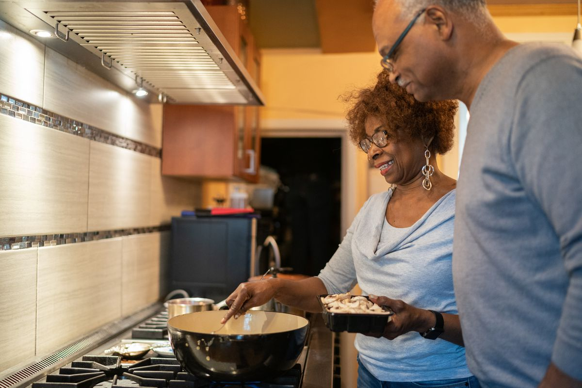 Ron Reid watches his wife, Serethea, prepare an all-vegan dinner on May 30, 2019. No meat, no fish, no dairy, nothing that comes from an animal comprises the couple's diet.