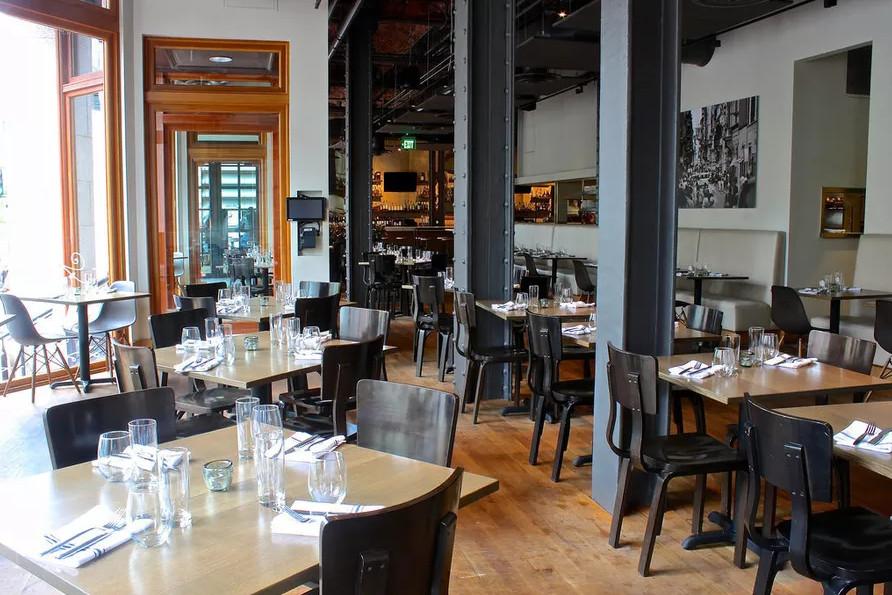Restaurant interior featuring sleek lines and light wood
