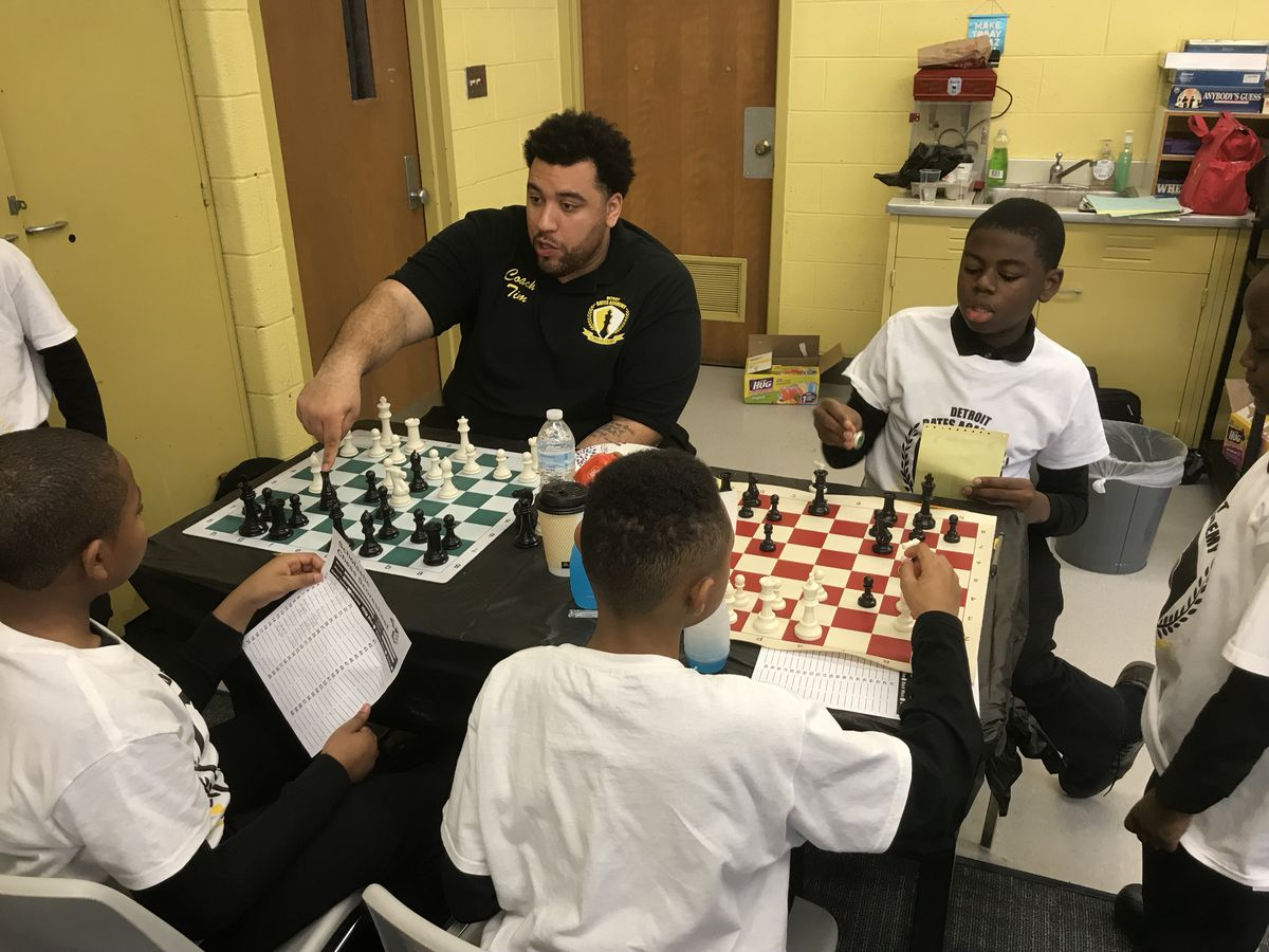 Timothy Speight, one of the coaches at Bates Academy, practices with students during the state chess tournament Saturday in Detroit.