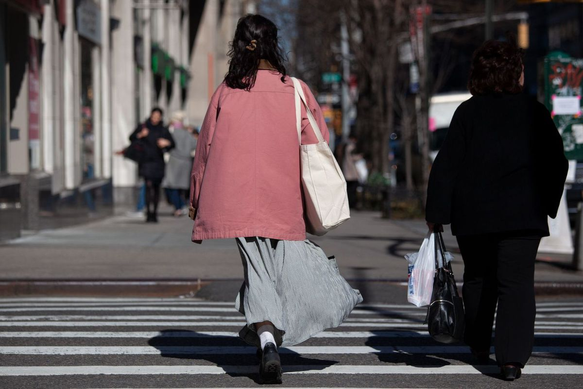 A shopper totes goods in a reusable bag along Seventh Avenue in Chelsea.