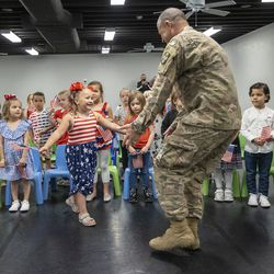 Aria Gustavson reacts to seeing her father, U.S. Army Reserve Staff Sgt. Dan Gustavson, of the 312th Medical Logistics Company out of Seagoville, Texas, during a surprise homecoming at Vision Dance and Learning in South Jordan on Monday, May 3, 2021. Gustavson has been serving in Iraq for nine months.