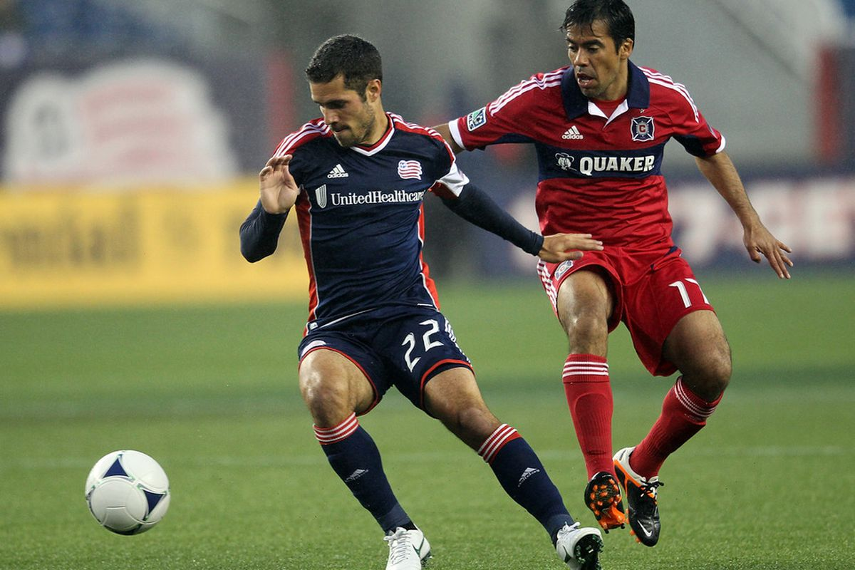 FOXBORO, MA - JUNE 2:  Benny Feilhaber #22 of the New England Revolution steal the ball from Daniel Paladini #11 of the Chicago Fire at Gillette Stadium on June 2, 2012 in Foxboro, Massachusetts. (Photo by Jim Rogash/Getty Images)