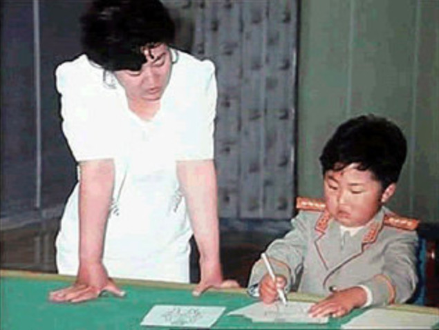 """This image of a young Kim Jong Un being doted on by his mother Ko Yong Hui is from an official North Korean government documentary about Ko titled """"The Mother of the Great Military-First Korea."""""""
