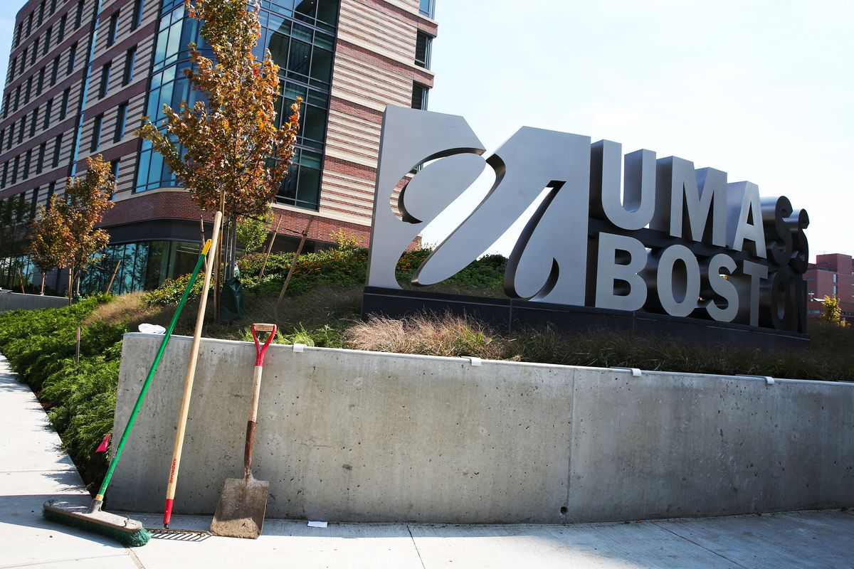 The large metal sign for a new dormitory.