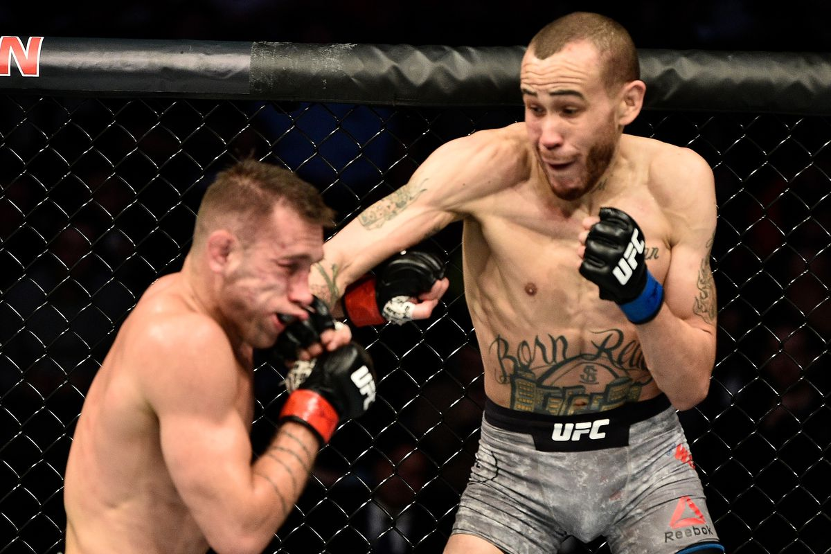 Sean Woodson punches Kyle Bochniak in their featherweight bout during the UFC Fight Night event at TD Garden on October 18, 2019 in Boston, Massachusetts.