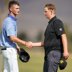 Bode Salas from Carbon High School, left, shakes hands with Union High School's Tytan Birchell while competing in the 3A boys state championship at Oquirrh Hills Golf Course in Tooele on Thursday, Oct. 7, 2021.