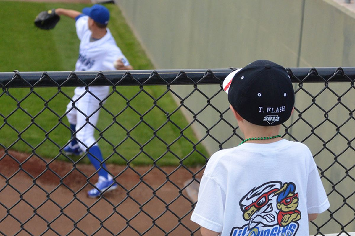 A young fan watches Justin Marks warm up in the bullpen in Omaha
