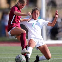 Farmington's Kennedy Freeman kicks the ball away from Viewmont's Landree Evans as they battle to a 1-1 tie at the end of regulation play in Bountiful on Tuesday, Sept. 22, 2020. Farmington went on to advance with a 3-1 win in penalty kicks.
